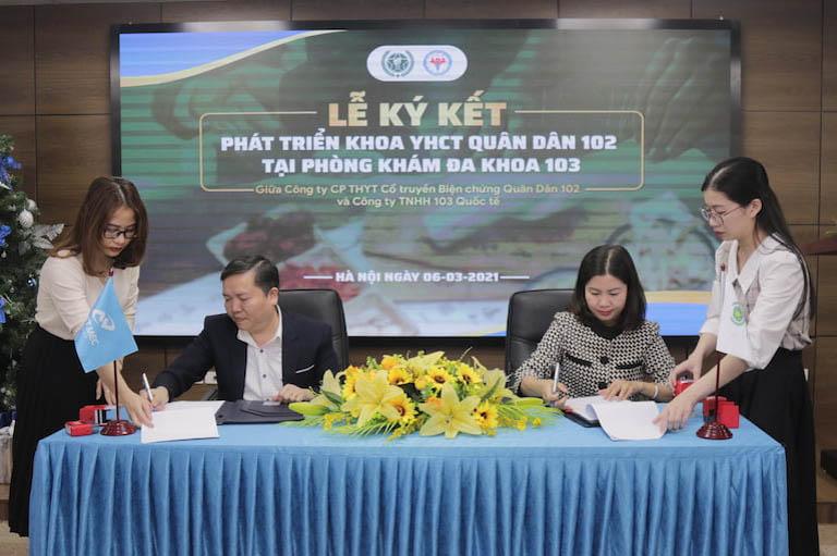 Lê Quốc Tuấn – Chủ tịch HĐQT, TGĐ công ty TNHH 103 Quốc tế và bà Trần Thanh Hằng( TGĐ Quân dân 102) đại diện ký kết